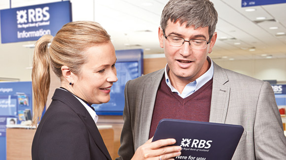 RBS staff assisting a customer in bank