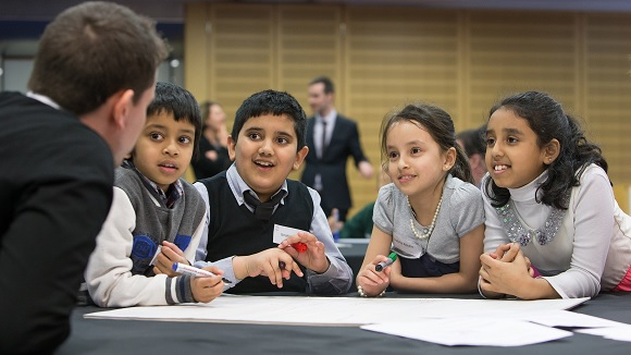 Children learning at MoneySense event