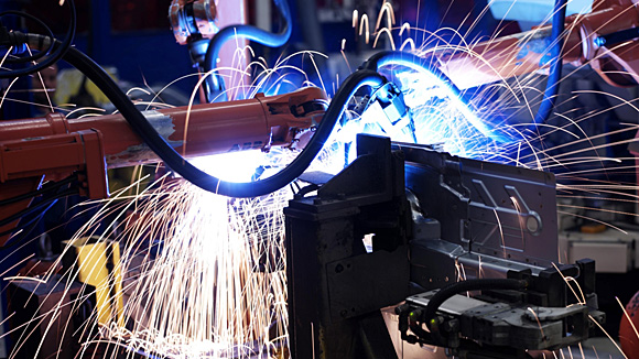 Sparks coming out of a machine in a manufacturing factory