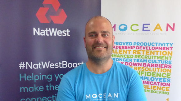 Entrepreneur Mick Lindsay with NatWest and Mocean banners behind him