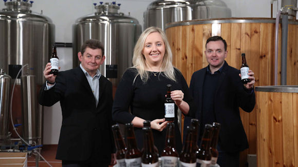 Lynsey Cunningham, Ulster Bank; with Brendan Smyth, left, arc-net; and Liam Brogan, right, Ireland Craft Beers with the new Downstream beer.