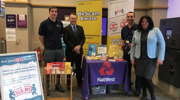 NatWest CEO of Personal and Business Banking, Les Matheson and others at the NatWest Norwich branch launching the little book of big scams