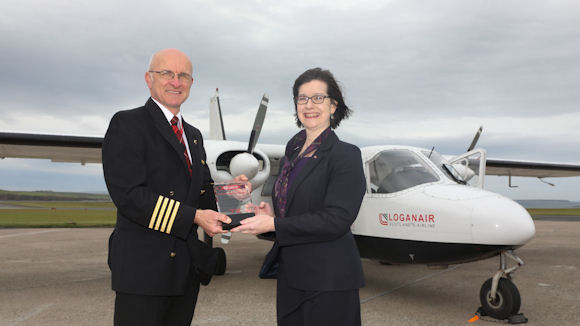Royal Bank of Scotland's 'flying banker' Anne Rendall with Loganair pilot Colin McAllister