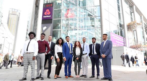 10 successful candidates of NatWest's apprentice programme outside NatWest building at 250 Bishopsgate London
